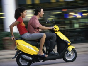 young-couple-riding-on-a-motor-scooter