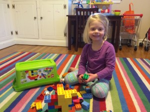 charlotte playing with Duplos