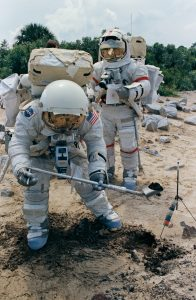 The 20 Bag Dispenser being used by two astronauts