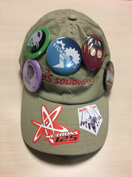 Team buttons on a SOLIDWORKS hat.