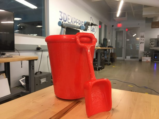 A sand pail and sand shovel designed and 3D printed with SOLIDWORKS Apps for Kids