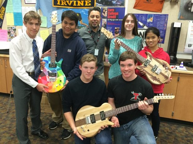 Ed Hernandez and his students with guitars they made. Image credit: Ed Hernandez