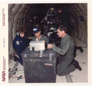 A picture of Charlie, Joe and Linda in the Zero Gravity Boeing KC-135 air craft doing the first Zero Gravity experiments